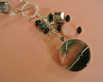 Beautiful Multi-colored Necklace and Earring set.Teal, Peachy-Pink, Black colored focal piece. Unique lariet style, Handmade
