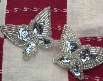 "2 Vintage Silver Sequined and Beaded  Butterfly Appliqués   2 1/2""  x 2"",  never used."