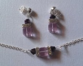 Necklace & earrings of violet AB Swarovski crystal cubes hugged by clear crystal squaredelles and metallic purple bicones. Silver chain