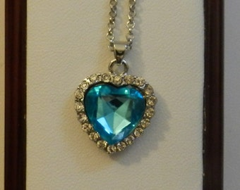 Silver Heart Shaped Blue Crystal Necklace. V9