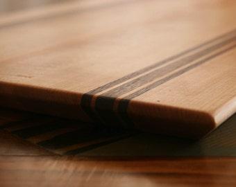Maple, Walnut & Padouk Wood Cutting Board, or serving board, in a Striped Pattern