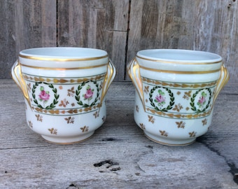 Pair of hand painted planters Limoges for Ebeling and Reuss signed