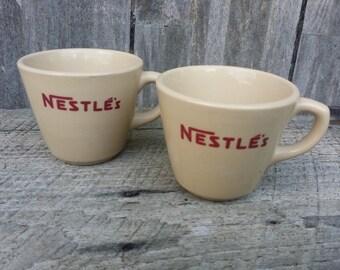 Pair of Inca ware Shenango Nestle's cups