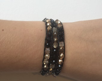 Gold, black, and clear leather beaded wrap bracelet