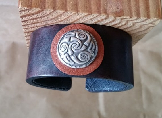 "Brown LEATHER CUFF with Celtic Knot Spiral Silver Concho. Medium 7"" Size. Lined. Oxblood Latigo Wristband. Men, Women, Unisex. Hook Clasp."