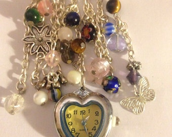 Brooch watch made with semi precious stones