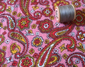 length of pink paisley design cord dressmaking fabric