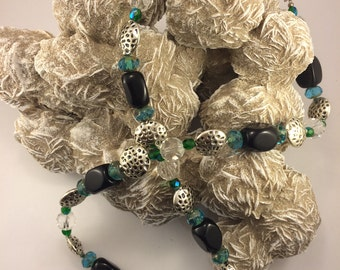Fire aqua faceted bead with Onyx, cut crystal and pewter necklace