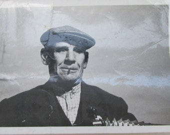 Vintage 1930s Black and White Photograph - Smoking Man in Flat Cap Playing the Accordian