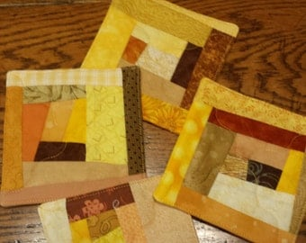 Set of Four Yellow-Orange Fabric Coasters