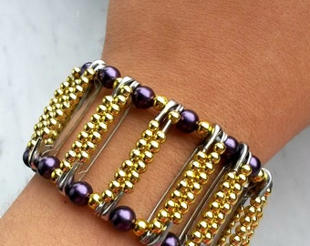 Purple and gold bracelet with safety pins and beads
