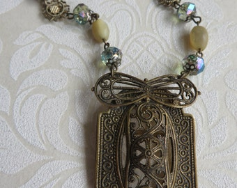 Vintage necklace repurposed in ornate gold tone metal filigree,         handcrafted vintage necklace, glass & mother of pearl beads, bespoke