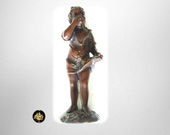 Bronze figurine of young girl blowing a kiss - signed