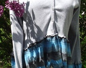 """Upcycled Size Medium sweater with high in the front, long in the back great """"t-shirt"""" ruffle. Matching ruffle on sleeves. Front unbuttons."""