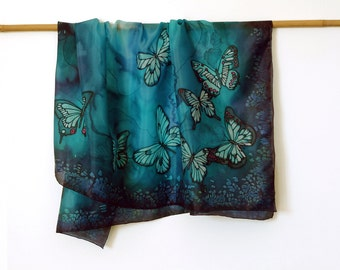 Blue hand painted silk scarf with butterflies. Approx 35x35 inches.