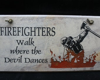 Firefighters Walk Where Devil Dances Sign