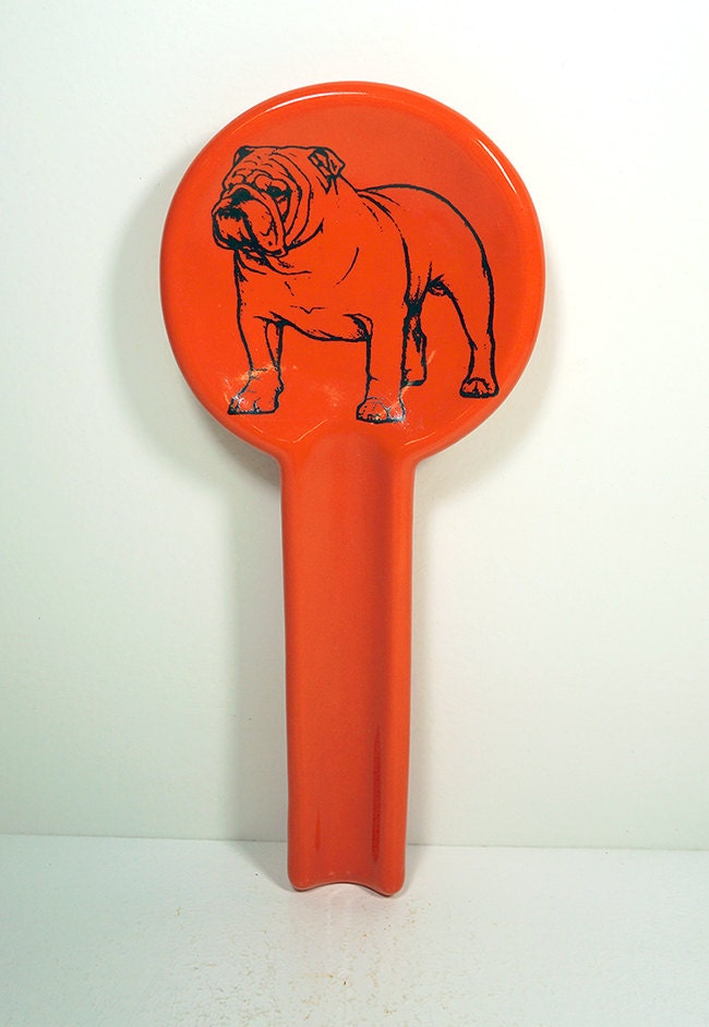 spoon rest shown here in the Clementine glaze with a bulldog on it. Made to order / Pick your colour