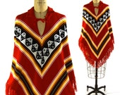 Fringed Poncho / Vintage 1970s Knit Chevron Poncho with Tassel Trim