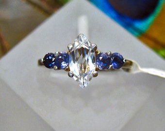 Topaz and Iolite Ring: White Topaz Marquise with Round Iolite Side-stones Sterling Silver Ring - Size 7