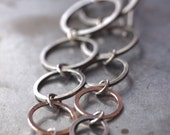Funky, cascading 14k pink gold and silver mixed metal hoop earrings