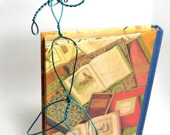 Waving Blue Mermaid - bookshelf mermaid wire sculpture sits on shelf - wavy hair , deep dark teal blue