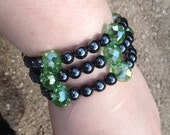 Hematite and Chinarovski Bracelet - memory wire - green