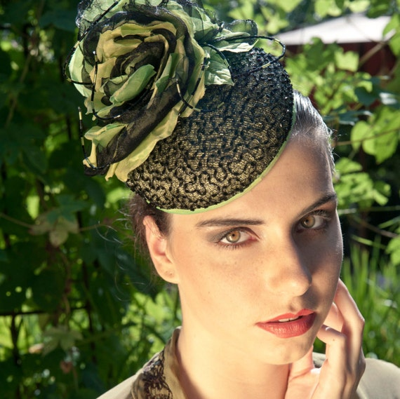 Couture completely handmade cocktail hat in black and springgreen with many many beads on aliceband