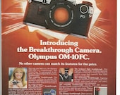 1982 Advertisement Cheryl Tiegs for Olympus Camera OM 10FC Celebrity Super Model Fashion Photography Studio 35mm Film 80s 82 Wall Art Decor