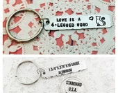 STORE CLOSING SALE Love Is A Four Legged Word, Cat, Cat Mom, Cat Owner, Love, Hand Stamped, Keychain, Key Chain, Angelorian Tradition