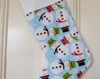 Christmas stocking - snowmen on a turquoise background