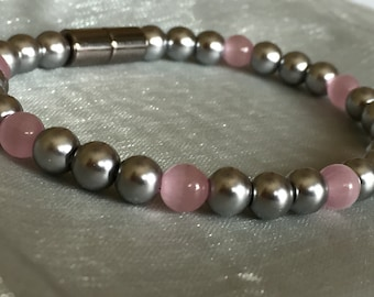 Silver Magnetic Pearl Bracelet with Pink Cat's Eye accents!