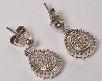 10 Karat White Gold Earrings adorned with diamonds
