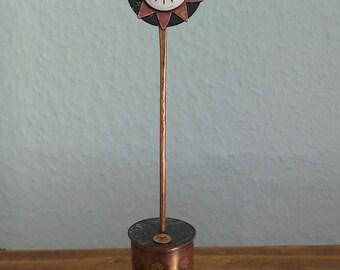 Copper flower in a pot.x
