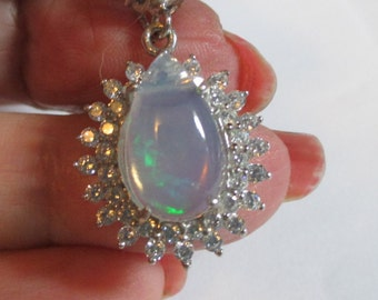 Stunning 2.4ct genuine opal with accents and genuine 1ct sapphire in top of the bail sterling silver pendant