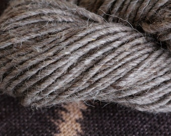 Navajo Churro rug weight wool yarn in MEDIUM GREY color.  Tightly spun, single ply sold in 4 oz/100 yd hanks.