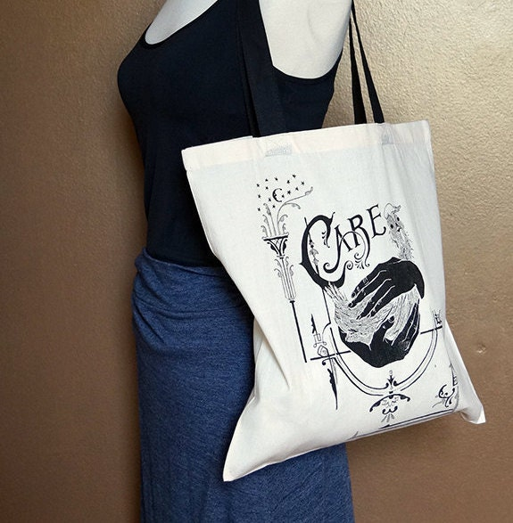 "Tote bag ""Care,"" black on natural white"