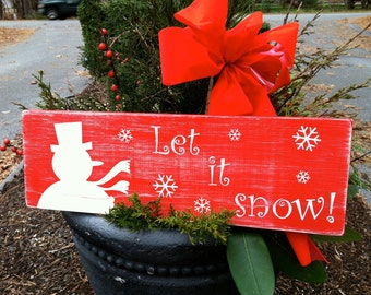 Custom hand-painted holiday wood signs.
