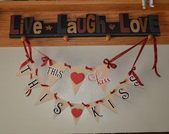 This kiss this kiss wedding banner