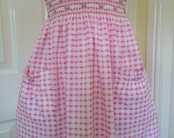Girls dress. Pretty pink and white girls hand smocked dress, age 4 to 5