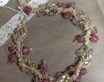 Rope necklace with glass beads.