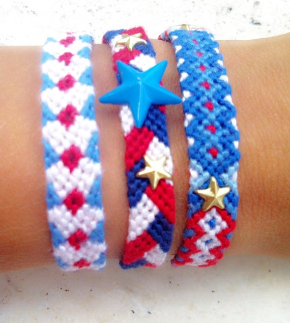 Set of 3 bracelets. Handwoven friendship bracelets in red, navy, blue, white with spikes.