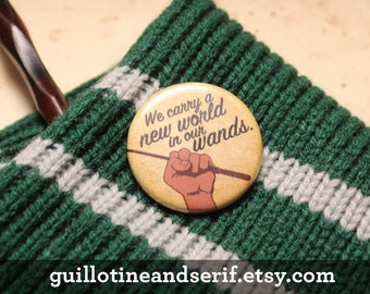 """We carry a new world in our wands. 1.25"""" button"""