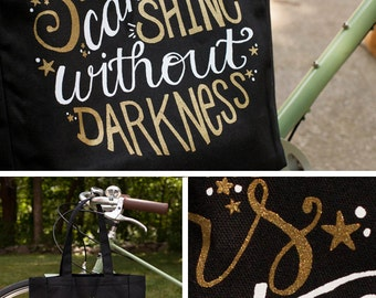 Tote bag with quote, calligraphy gold sparkle on black market bag, hand lettered Stars Can't Shine Without Darkness, limited edition