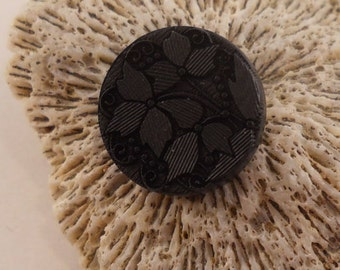 BUTTONS:  Black buttons with the look of vintage glass.  5/8 inch, shank, very detailed floral.