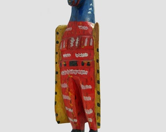 Wood- carving of a carnival character
