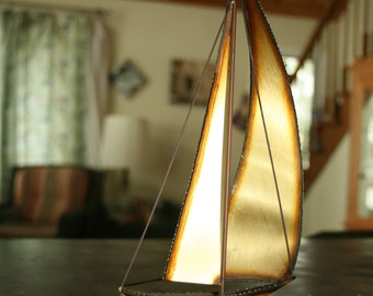sailboat sculpture, signed metal and stone sculpture