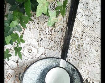 Vintage enamelware kitchenware black and white ladle