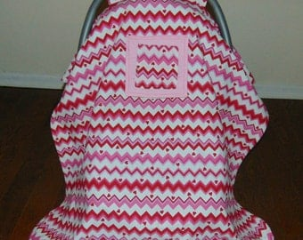 Baby car seat cover/ canopy, with peek a boo window.