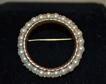 """Vintage round pearl brooch by Trifari. 1.25"""" diameter. Gold tone setting. Nice weight to this piece."""