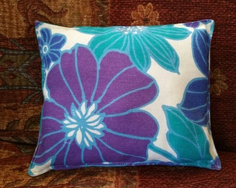 Lovely blue flowered decorative stuffed cushion